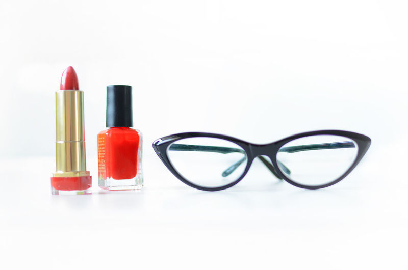 Make-up Beauty Product Beauty Still Life White Background Studio Shot Variation Red Glamour Body Care And Beauty Lipstick Females Indoors  Close-up Copy Space Fashion Group Of Objects Glasses Choice Cut Out Nail Personal Accessory Eyewear