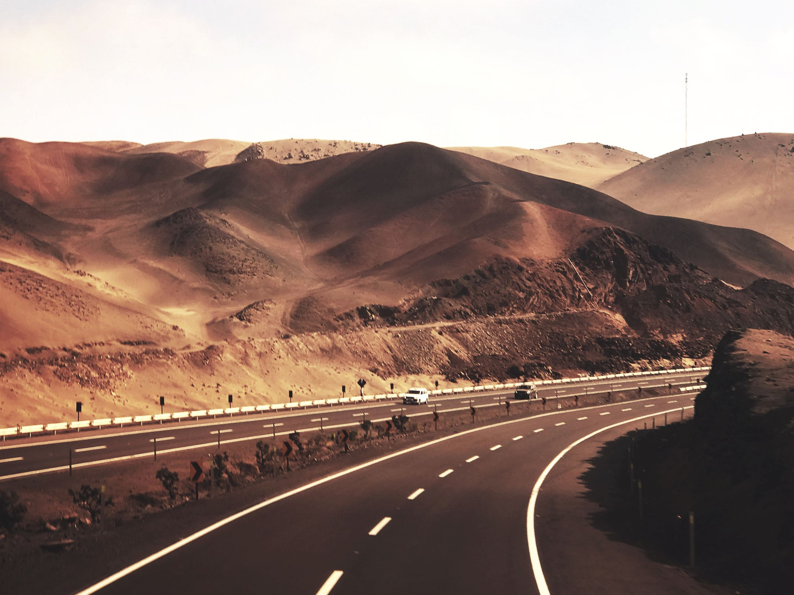 road, transportation, mountain, sky, direction, the way forward, road marking, marking, nature, symbol, scenics - nature, no people, desert, sign, car, mountain range, environment, landscape, motor vehicle, beauty in nature, outdoors, arid climate, climate, dividing line, formation