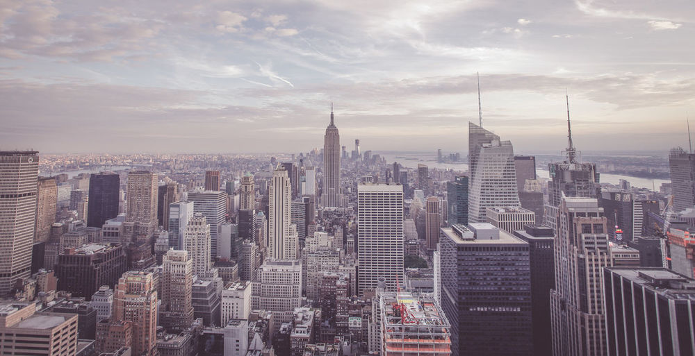 Manhattan against cloudy sky