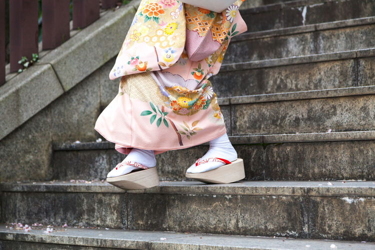 Going down the stairs in kimono Culture Geisha's Shoe Human Foot Japan, Tokyo Japanese Geta Japanese Shoes. Japanese Traditional Clothe Kimono Low Section Person Staircase Standing Steps