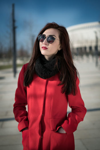 City Park. Portrait Krasnodar Architecture Beautiful Woman Building Exterior Day Fashion Focus On Foreground Front View Jacket Leisure Activity Lifestyles Long Hair Looking At Camera One Person Outdoors Park Portrait Real People Red Sky Standing Sunglasses Warm Clothing Young Adult Young Women