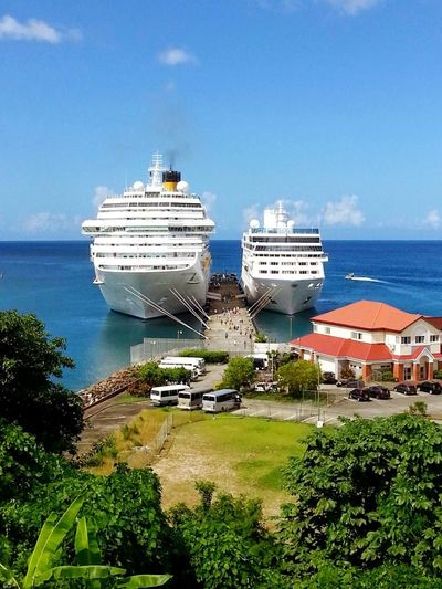Sea Nautical Vessel Beach Building Exterior Mode Of Transport Sky Ships Caribbean Trees Palm Cruise Ship Outdoors Day Harbor Nature Landscape Horizon Over Water Yacht No People Water