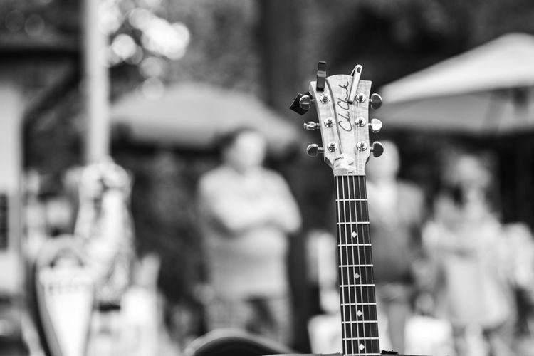 Black & White FUJIFILM X-T10 Arts Culture And Entertainment Backstage Acoustic Black And White Black And White Friday Close-up Concert Day Focus On Foreground Fretboard Fujifilm Guitar Music Musical Instrument Musical Instrument String Musician Outdoors Performance Popular Music Concert Real People