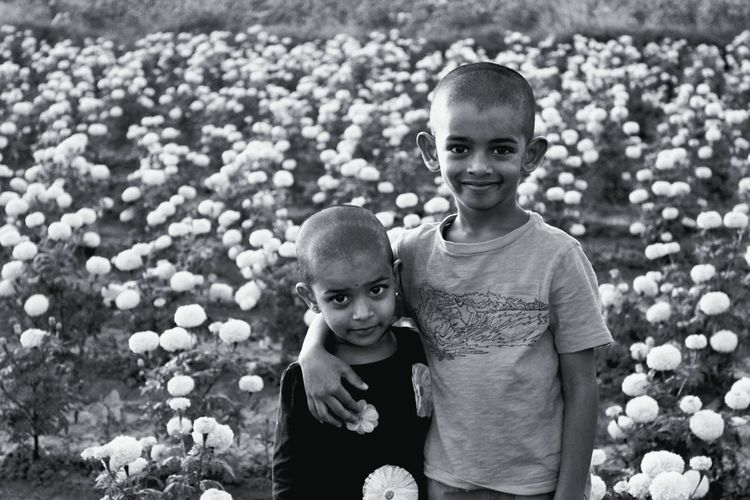 Kids Portrait Child Childhood Males  Togetherness Boys Smiling Looking At Camera Happiness Bonding Brother Sibling Blooming Family With Two Children Son Sister In Bloom Flower Head Growing Family Elementary Age Adoption 2018 In One Photograph Moments Of Happiness