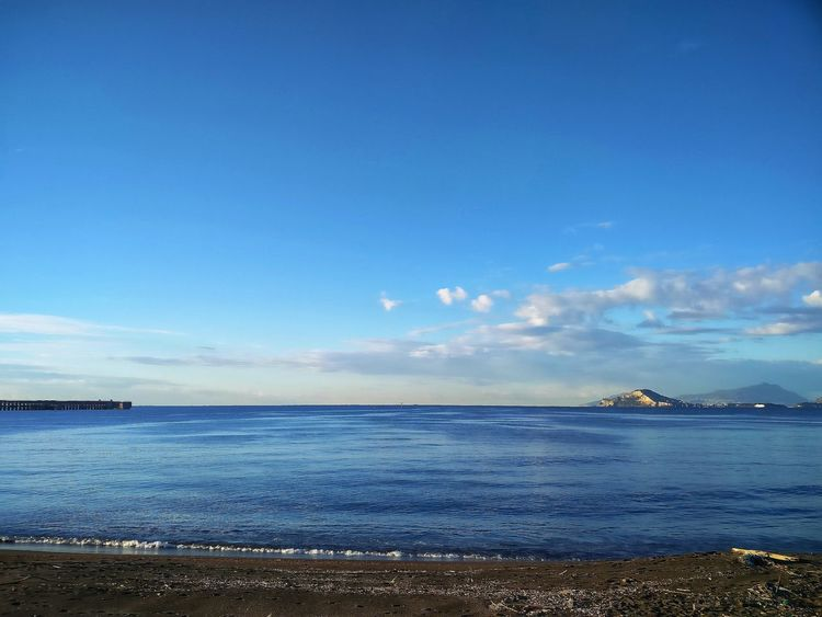 Buongiorno da Napoli #napoli #mauryhappy #buongiorno Sea Beach Blue Horizon Over Water Water Sky Outdoors Tranquility Sand Day Landscape Beauty In Nature Scenics Cloud - Sky No People Travel Destinations