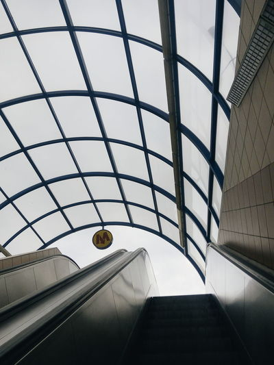 Low angle view of escalators in railroad station