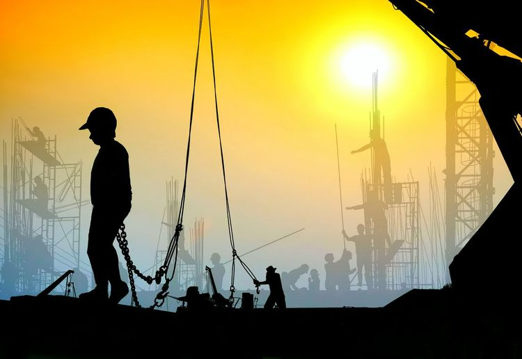 Silhouette construction workers group are working with wire rope sling and crane are blurred construction site on sunrise sky background in evening time Site Colorful Sunset Males  Industry Industrial Technology Construction Illustration Workers Group Team Reinforcement Infrastructure Sunrise Dunset Crane Sunshine Working Wire Rope Sling Blurred Background Engineering Engeneer Full Length Occupation Men Silhouette Skill  Sunset Sky