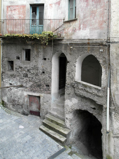 Glimpse of the historic center of Verbicaro Abandoned House Doors Historic City Italia Old Town South Italy Abandoned Architecture Balcony Building Exterior Built Structure Calabria Glimpse History House Outdoors Steps Travel Destination Verbicaro Window Windows
