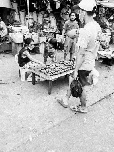 People sitting in market