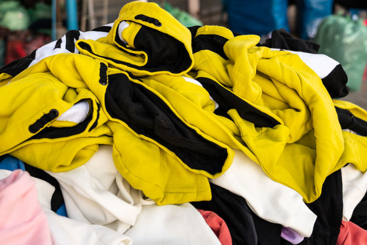 Close-up of stacked clothes for sale