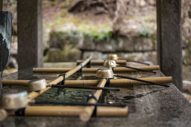 Cleansing fountain at temple entry Japan Photography Ritual Bamboo - Material Belief Buddhism Built Structure Cleansing Day Drinking Fountain Flowing Flowing Water Fountain Japanese Garden Ladle Nature No People Outdoors Religion Selective Focus Shrine Temple Water Wood - Material