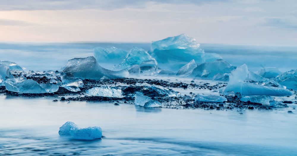 Glacier Lagoon iceland Beauty In Nature Cold Temperature Environment Floating On Water Frozen Glacier Horizon Over Water Ice Iceberg Iceberg - Ice Formation Landscape Melting Nature No People Outdoors Scenics - Nature Sea Sky Snow Tranquil Scene Tranquility Water Winter