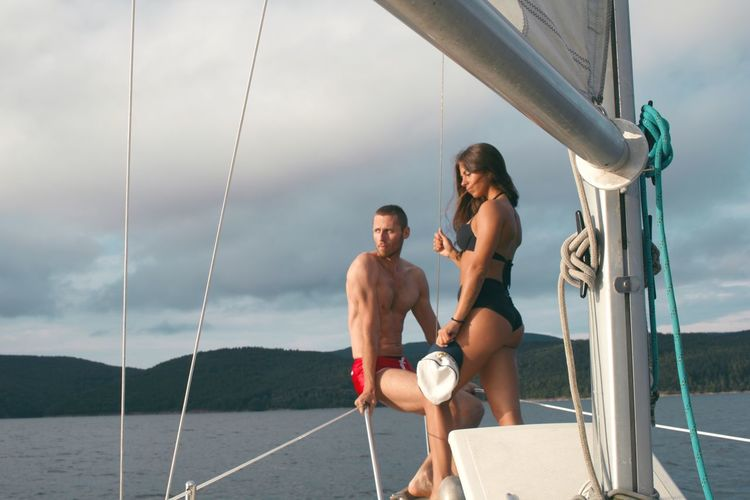 Couple in love on a romantic yacht trip Couple Love Man Romantic Summertime Woman Boat Lake Lake View Leisure Activity Lifestyles Nature Sea Sky Summer Sunset Two People Water Yacht Yachting