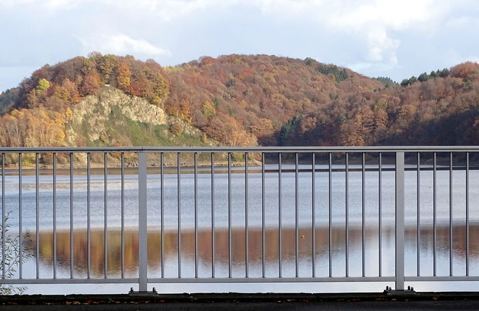 Herbst an der Talsperre Autumn Drinking Water Railing Reflection Wahnbachtalsperre Beauty In Nature Bridge - Man Made Structure Day Drinking Water Reservoir Mountain Nature No People Outdoors Scenics Sky Tranquility Tree Water