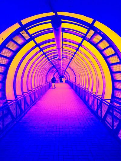 Bubblegum city Architecture The Way Forward Direction Built Structure Diminishing Perspective Illuminated Pattern Bridge Railing vanishing point Transportation Metal Footpath No People Connection Arch Indoors  Tunnel Ceiling The Creative - 2019 EyeEm Awards