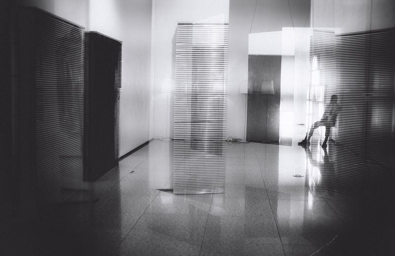 Reflection of person on window in building