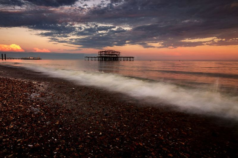 old pier and Sunset. United Kingdom Uk England Seascape Beach Longexposure EyeEm Selects Water Sea Sunset Beach Wave Reflection Beauty Sky Horizon Over Water Seascape Low Tide Bay Of Water Tranquil Scene Scenics Coast Coastline EyeEmNewHere 17.62°