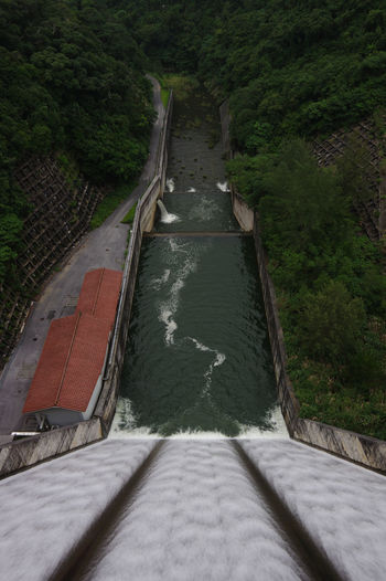 High angle view of bridge over river amidst trees