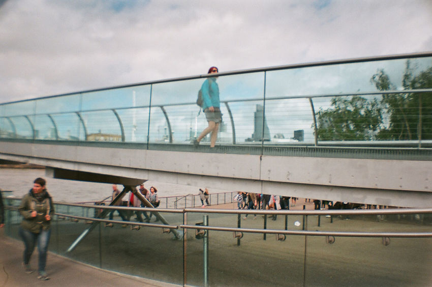 London on 35mm film. 35mm Film Adult Analog Analogue Photography Architecture Bridge - Man Made Structure Built Structure Cloud - Sky Connection Day Film Photography Filmisnotdead Large Group Of People Leisure Activity Lifestyles Millenium Bridge People Railing Real People Sky Streetphotography Walking Women EyeEm LOST IN London