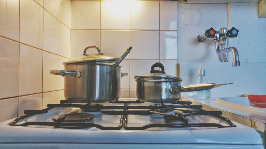 Kitchen Utensil On Stove At Home