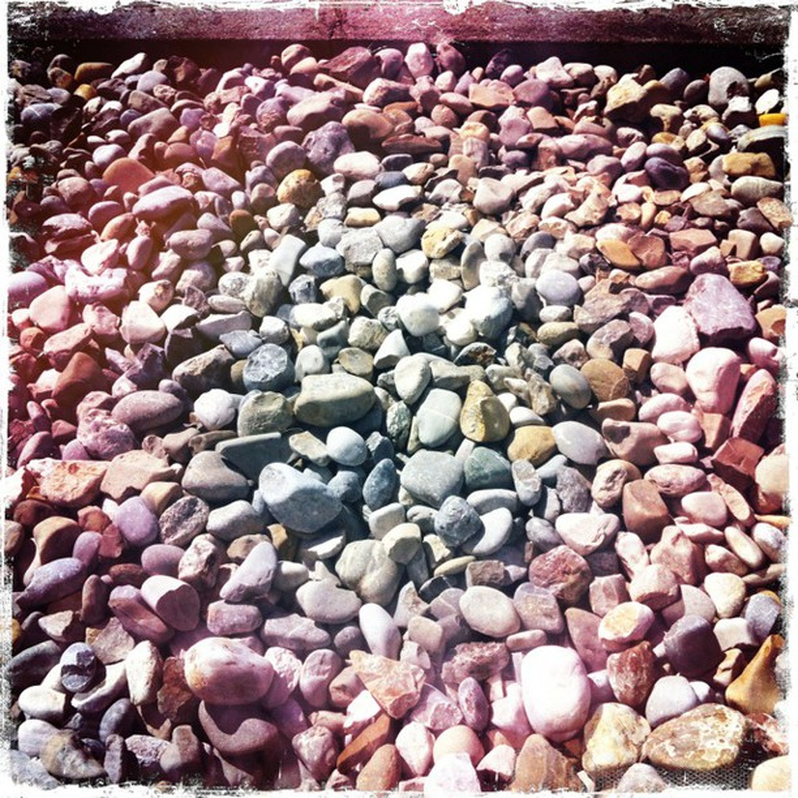 transfer print, full frame, backgrounds, auto post production filter, abundance, large group of objects, textured, stone - object, pebble, stack, heap, brown, no people, day, stone, outdoors, pattern, close-up, rock - object, wood - material