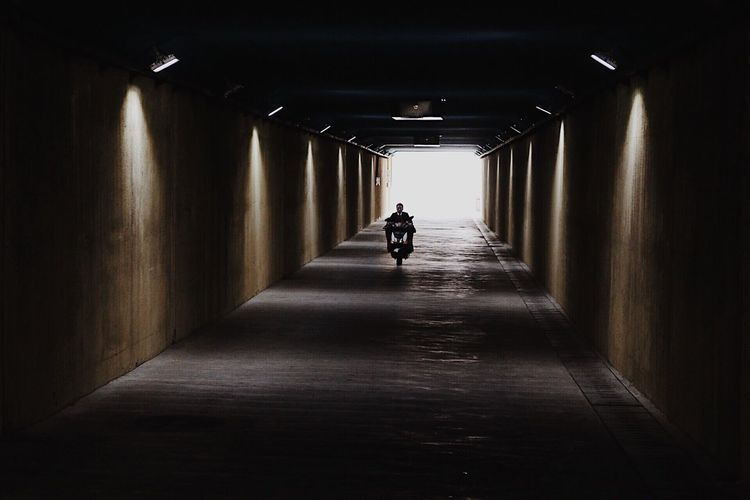 Silhouette man in tunnel