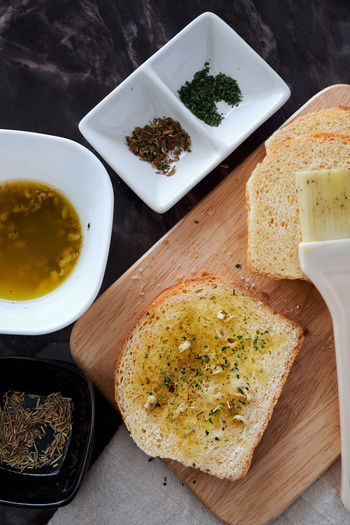 Bowl Bread Breakfast Brush Close-up Day DIP Directly Above Food Food And Drink Freshness Garlic Bread Healthy Eating High Angle View Indoors  No People Plate Ready-to-eat Sliced Bread Table Toasted Toasted Bread