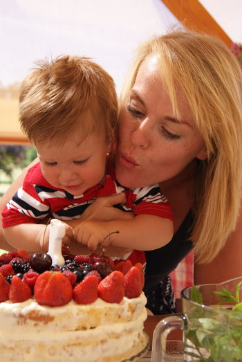 Mid Adult Woman With Son Celebrating Birthday