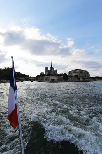 Cruising on the river Seine in Paris Boat Cruise Flag France Fun Holiday Paris River Seine Tourist Attraction  Tourists