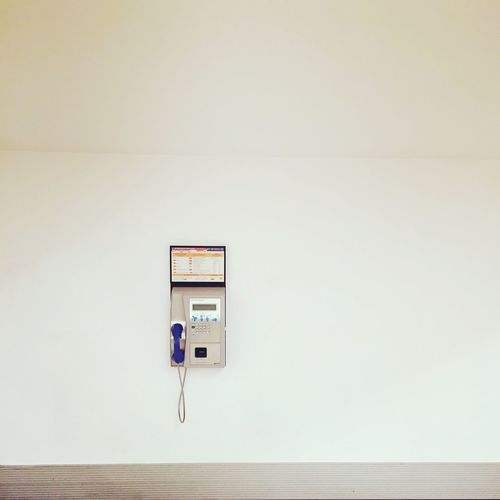 Pay phone hanging on wall
