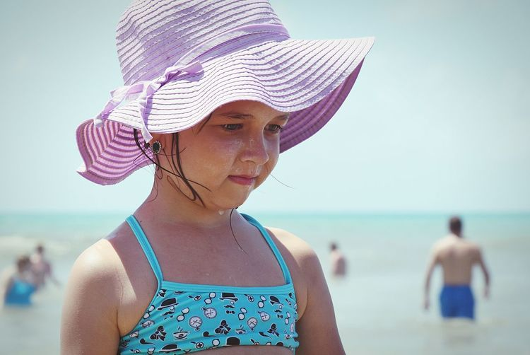 Close-up of girl wearing hat at beach