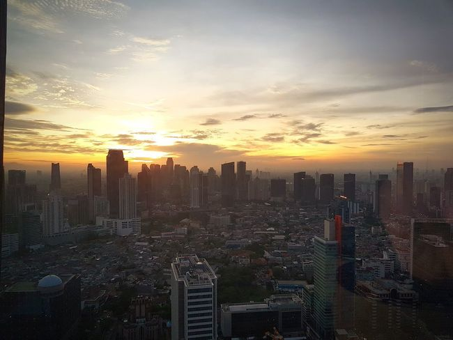 Golden hour in the capital Skyscraper Sunset Business Finance And Industry Cityscape Downtown District Dramatic Sky Modern Cloud - Sky Urban Skyline Architecture City Sky Dusk Jakarta Capital Cities  Indonesia Photography  Travel Destinations Building Exterior No People Business Illuminated Outdoors Landscape Photography Conected Whit Travel