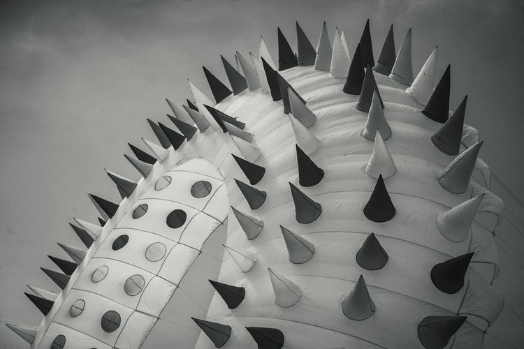 Circular kite at southsea international kite festival in balck and white.