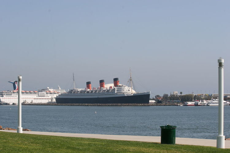 RMS Queen Mary Hotel and Museum from the northern side of Long Beach harbour 2010 Architecture Art Deco Interiors Cunard Line Cunard-White Star Line Day Historic Hotels Of America Hotel Hotel Ship Long Beach Harbour Museum National Register Of Historic Places Nautical Vessel No People Ocean Liner Outdoors Retired Ocean Liner Retired Ship RMS Queen Mary Ship As Hotel Sky Swimming Hotel Tourist Attraction  Transportation