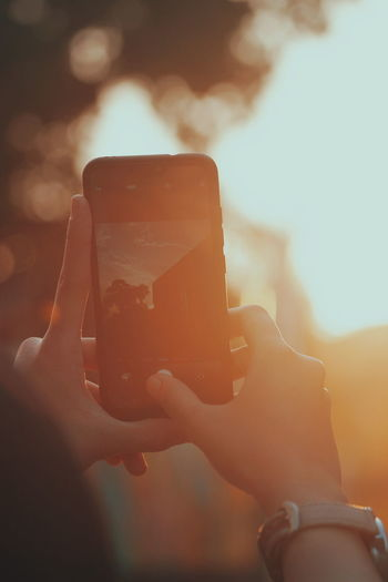 let photo talk about anything Sunset, PhonePhotography Phoneography Hand Sunlight Phonecamera Photography Themes Wireless Technology Selfie Photographing Telephone Women Mobile Phone Cellphone
