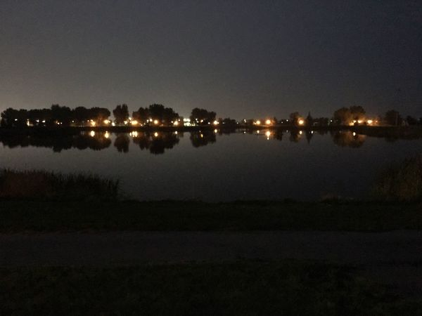 City lights in Gillette, Wyoming across the lake at Dalbey Park City Lights At Night Night Lights Illuminated Water Reflection Night Sky No People Nature Tranquility Lake Waterfront Tranquil Scene Scenics - Nature Outdoors Tree Beauty In Nature Glowing Reflection Lake Light