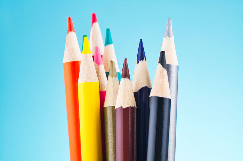 colourful pencils over beautiful reverberation gradient background Pencil Writing Instrument Multi Colored Colored Pencil Close-up No People Art And Craft Variation Choice Studio Shot Collection Blue Indoors  Still Life Group Of Objects Creativity Large Group Of Objects Craft Art And Craft Equipment Sharp Blue Background Variety