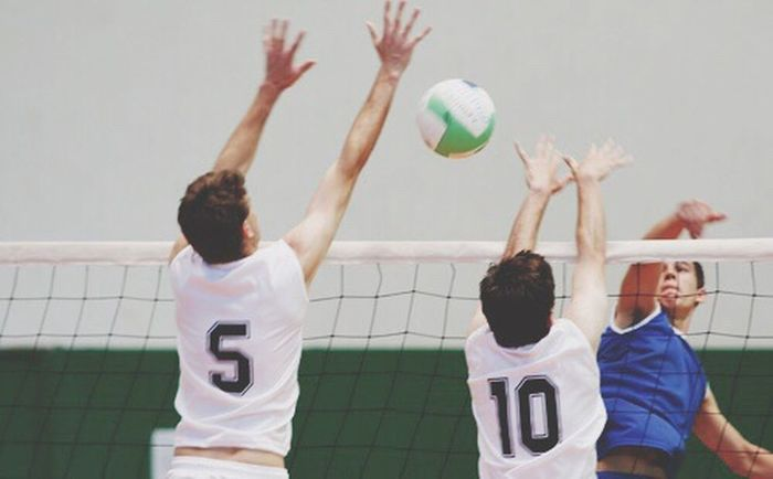Child Limb Human Limb Arms Raised Playing Sport Human Arm Looking Up Volleyball Human Body Part People Friendship Leisure Activity Competition Sports Clothing Team Sport Sports Team Outdoors Sports Uniform