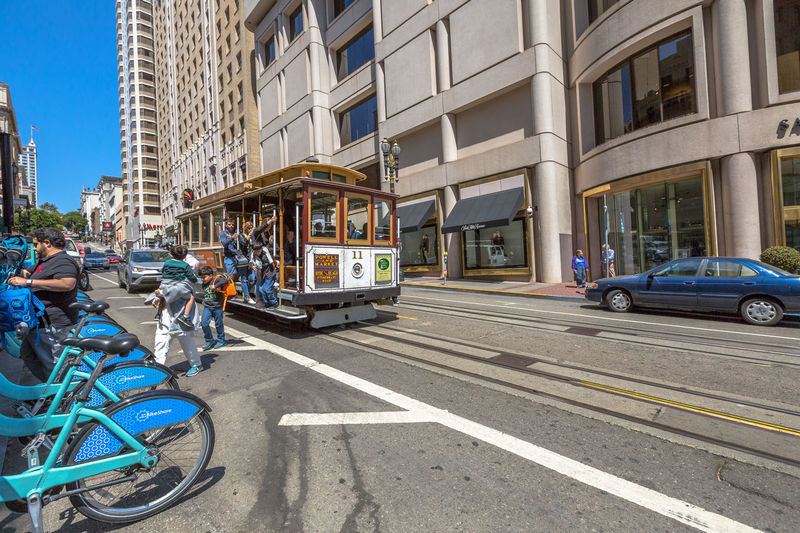 San Francisco, CA, United States - August 17, 2016: crowds of tourists in the popular Union Square, the central square of San Francisco on Market Street, known as the place shopping and luxury hotels. San Francisco, California, United States - August 17, 2016: the Big Bus, Hop On Hop Off, Sightseeing Tour, the popular double-decker bus carrying tourists, standing in Union Square, during a day tour. Cable Car California Market SF San Francisco Square Union Union Square SF United States Architecture Bicycle Building Exterior Built Structure Car City City Life Day Land Vehicle Market Street San Francisco Market Street Men Mode Of Transport Outdoors People Real People Road Sky Street Transportation Union Square  Unionsquare