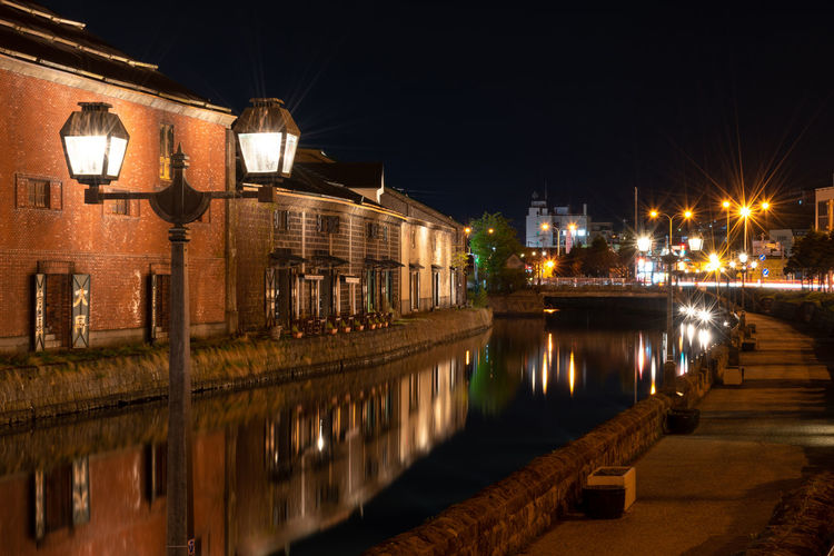 Landscape view of Otaru canals and warehouse at night in Hokkaido Japan. Here is a famous landmark of Otaru city. Text in Japanese is Otaru storehouse. Otaru Canal Hokkaido Japan Japanese Food Landmark Warehouse Architecture ASIA Backgrounds Beautiful Illumination Light Up Your Life Night Buildings City Downtown Evening Famous Place Prefecture River Scenics Spring Summer Fall Autumn Tourism Tourist Town Travel Asian  Attraction Boat Bridge Cityscape Colorful Destination Factory Historic Historical Old Reflection Sapporo Sightseeing Urban View Scenery Skyline Twilight Illuminated