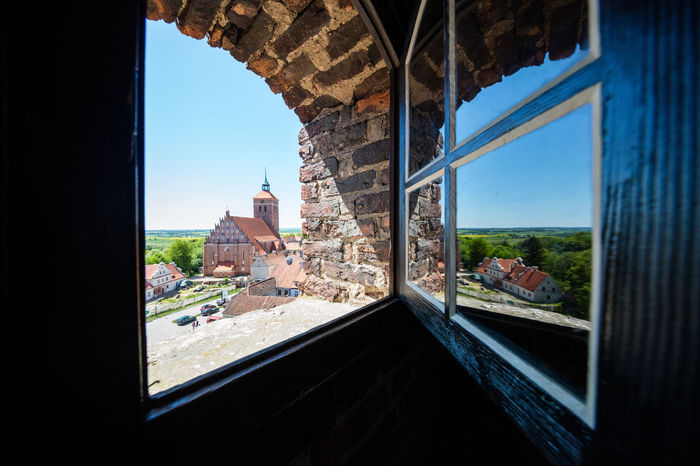 view from the tower of castel Reszel to the city Architecture Brick Wall Clear Sky Historic City Muesum Place Of Worship Poland Polska Sightseeing Travel View Ancient Civilization Blue Sky Brick Brick Building Building Exterior Built Structure Castel Day No People Reszel Sunshine Tower Travel Destinations Window