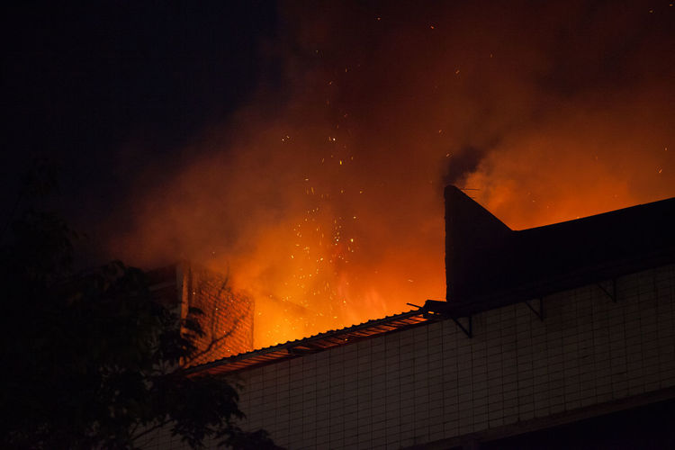 Building under fire at night