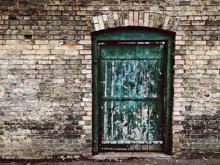 Close-up of closed window on brick wall