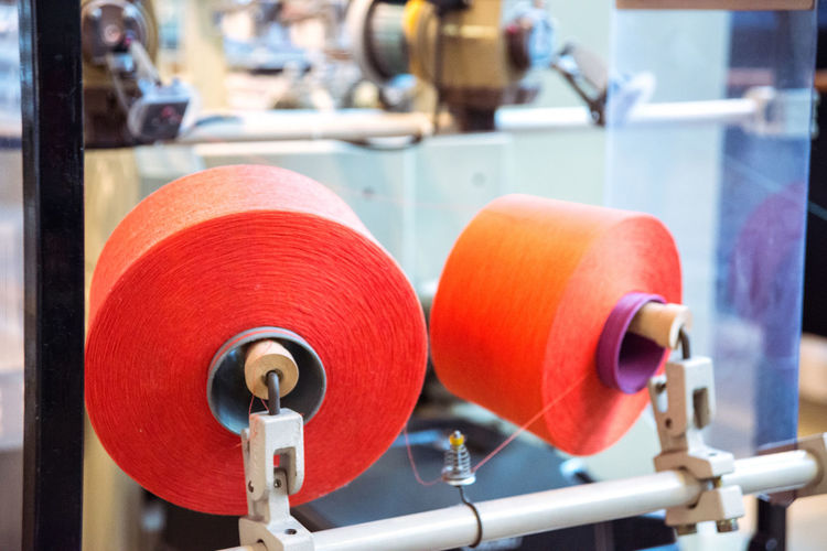 At the Toyota Museum in Nagoya, Japan Air Jet Machine Close-up Equipment Focus On Foreground In A Row Loom Machine Part Machinery Manufacturing Metal Red Selective Focus Sewing Spool Spool Spool Of Thread Tailored To You Textile Textile Industry Textile Machinery Weaving Loom Weaving Machine Ultimate Japan
