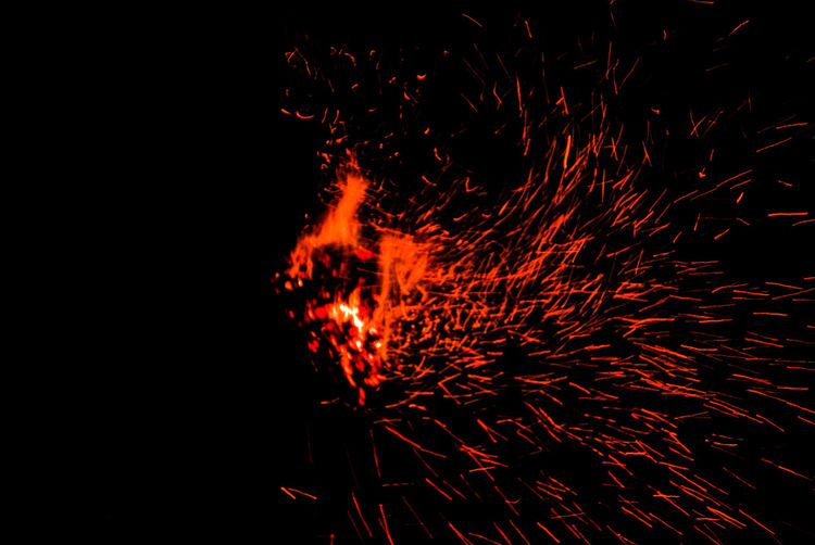 Heat - Temperature Exploding No People Flame Night Lava Erupting Outdoors Molten Close-up Cold Temperature Illuminated Red Ember Ashes Coal Colored Background Experimental Abstract Flame Burning Backgrounds Fall Silhouette Dawn Perspectives On Nature