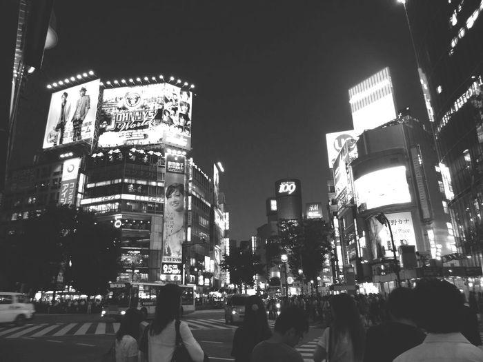 People on city street at night