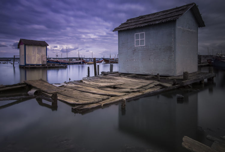 Architecture Building Building Exterior Built Structure Cloud - Sky Dusk House Lake Nature No People Outdoors Pier Reflection Residential District Sky Stilt House Tranquility Water Waterfront Wooden Post