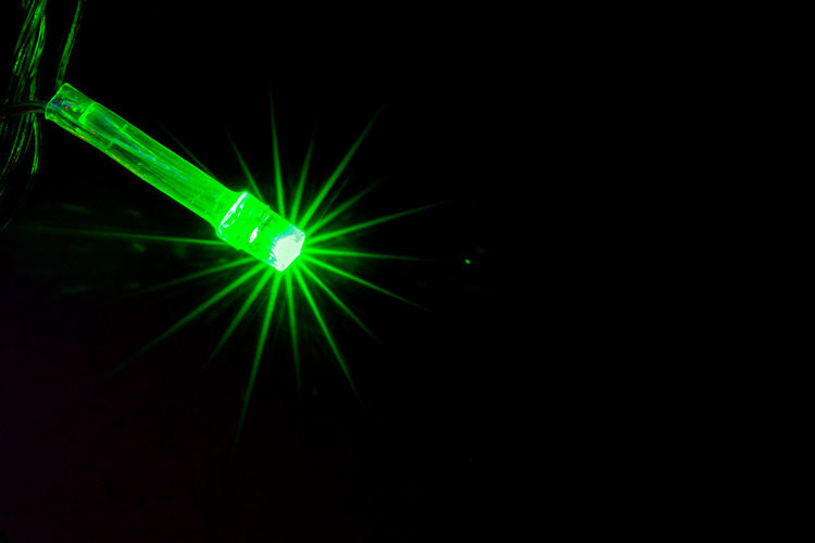 Close-up of illuminated lights in the dark