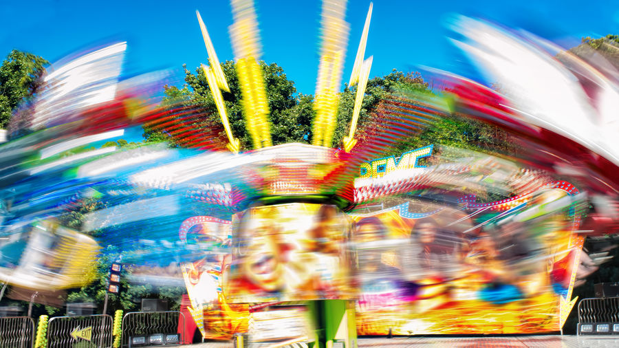 Colorful extreme ride at traveling fun fair. Adventure Parks Amusementpark Blur Blurred Motion Carnival Colors Day Out Extreme Extreme Rides Fair Fairground Family Fun First Eyeem Photo Fun Fair Holiday Low Angle View Motion Blur Outdoors Ride Spinning Sunset Thrill Thrill Rides Traveling Fair Vacation