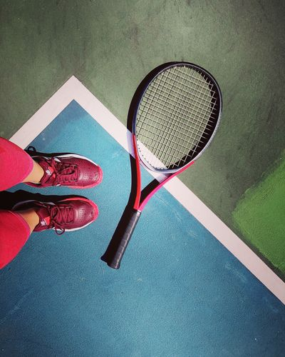 Athletic athleisure Athlete High Angle View Human Body Part Body Part One Person Low Section Tennis Human Leg Sport Lifestyles Racket Leisure Activity Shoe Shadow Tennis Racket Red Human Limb